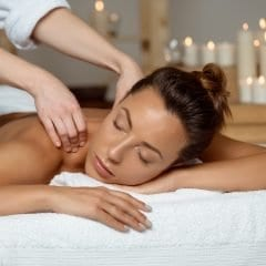 Image of Young woman having massage relaxing in spa salon.