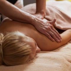 Image of Young woman enjoys massage in a luxury spa
