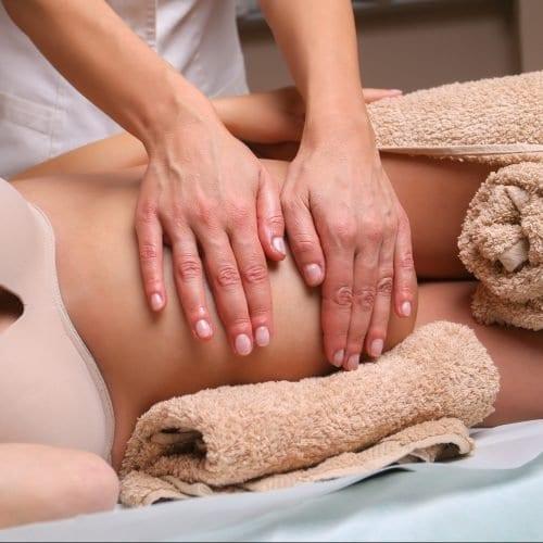 Image of Massage therapist massaging pregnant woman