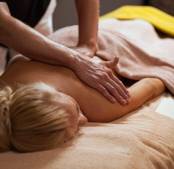 Young woman enjoys massage in a luxury spa