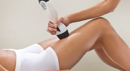 Image of a woman having a skin tightening treatment on her thigh