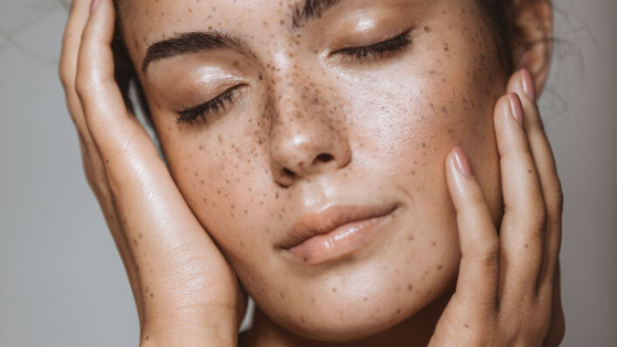 image of woman touching the face on her skin