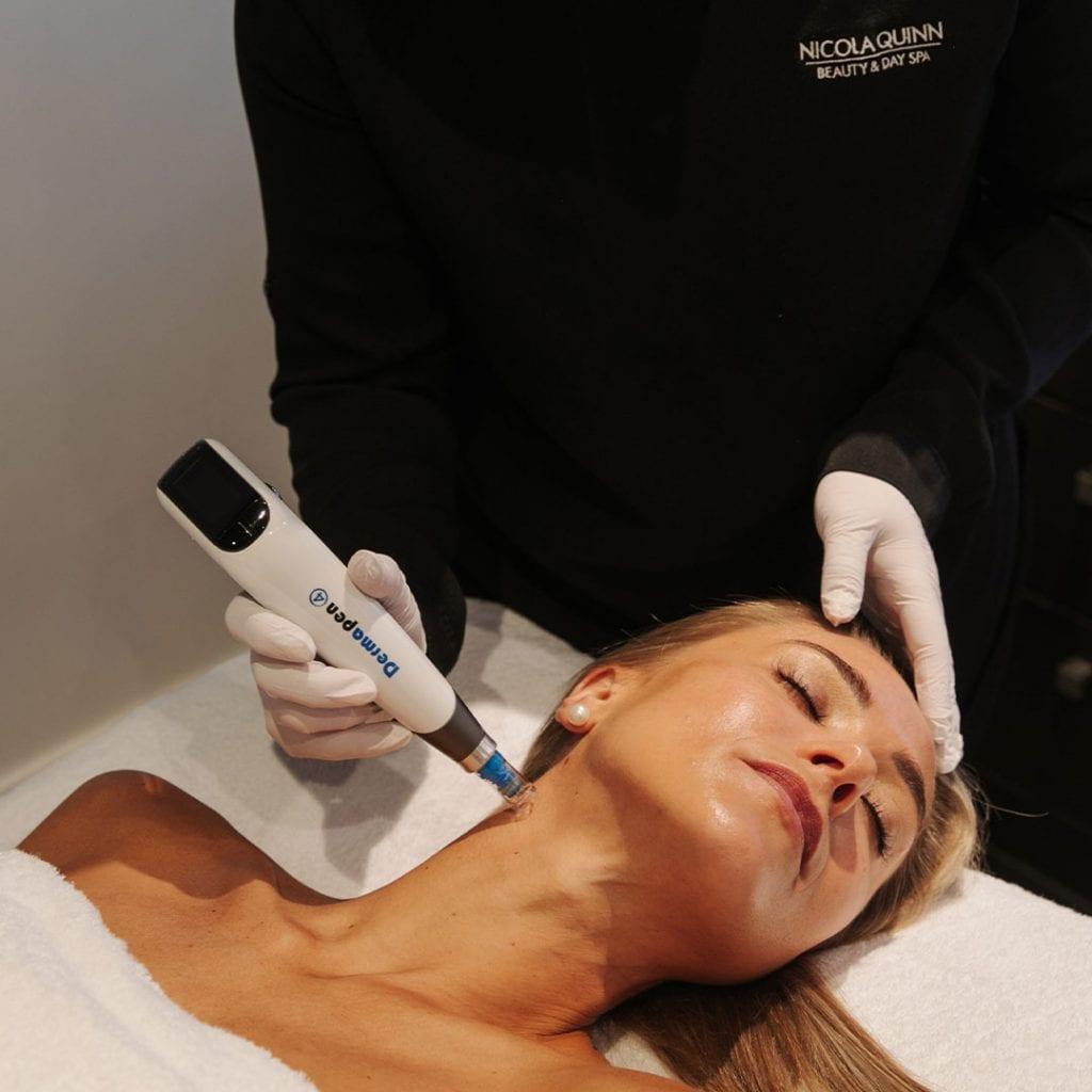 Woman having a dermapen microneedling skin treatment