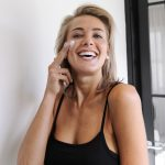 confident woman with glowing skin at nicola quinn beauty