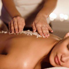 woman having a salt scrub spa treatment