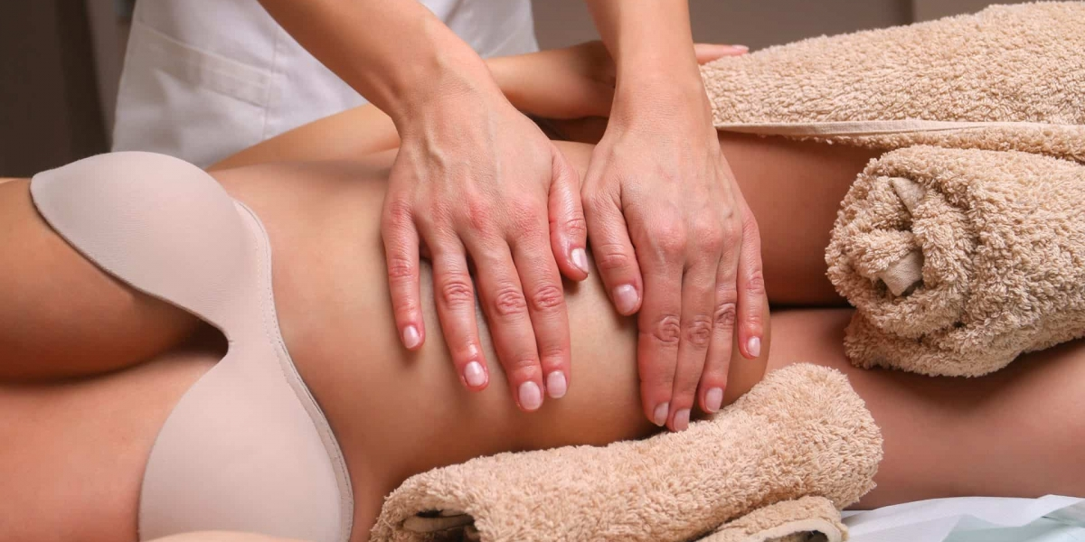 Image of Massage therapist massaging pregnant woman.