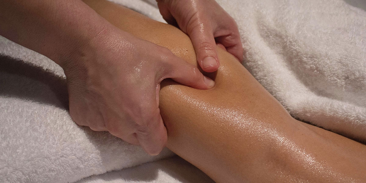 woman having a deep tissue massage in Christchurch nz